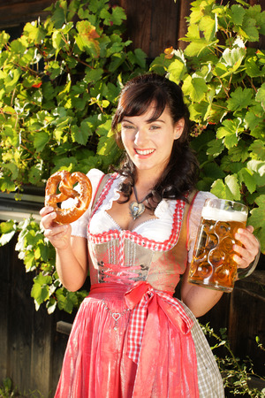 beerfest: Bavarian woman with glass of beer and pretzel