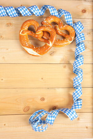 salty: Salty bavarian pretzels on wooden board Stock Photo
