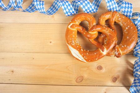 Salty bavarian pretzels on wooden board Stock Photo