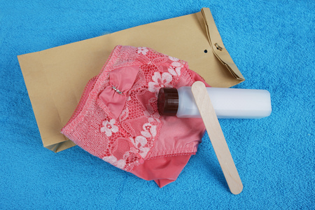 intestinal cancer: Stoolsample on a towel with bag Stock Photo