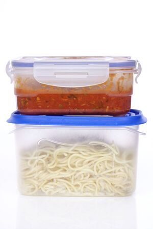 Two boxes with spagetti and pasta sauce Imagens