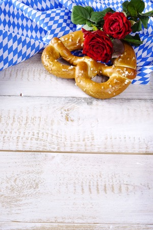 ble: Bavarian pretzel with roses on ble and white tablecloth