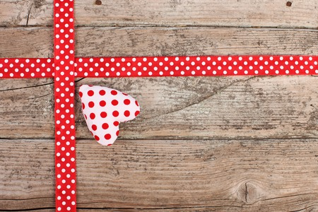 rustical: Ribbon with red polka dots and heart Stock Photo