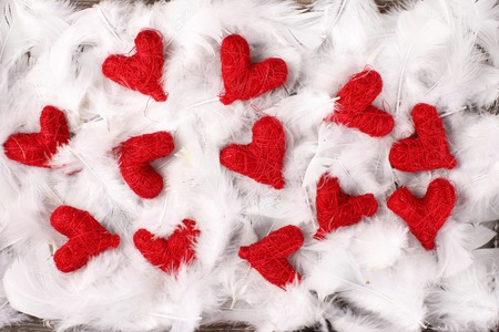 cordially: red hearts on white feathers
