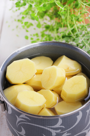 cooking pot: Potatoes in a cooking pot