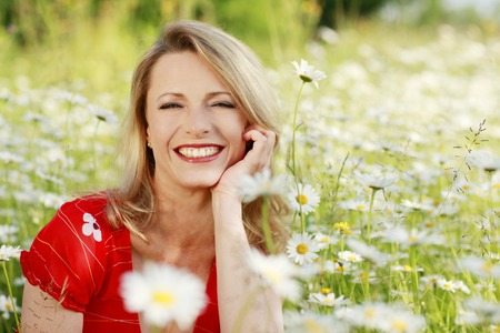 Happy woman in flower field Banque d'images
