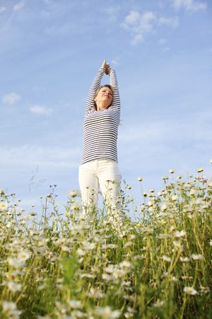 freedom woman: Happy woman with stretched arms in flower field