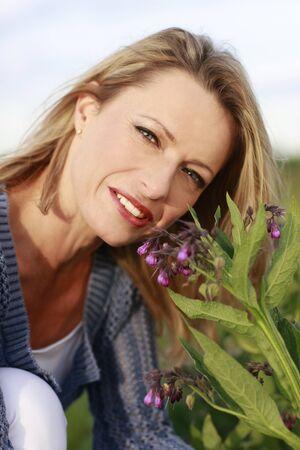 comfrey: Woman beside comfrey healing  plant
