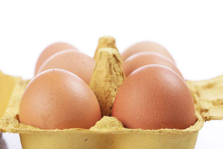 food stuff: eggs in colored egg box isolated