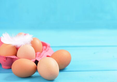 egg carton: colorful egg carton on blue background Stock Photo