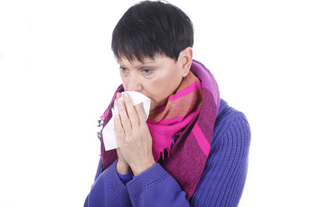 sinusitis: Elder woman with handkerchief and cold isolated