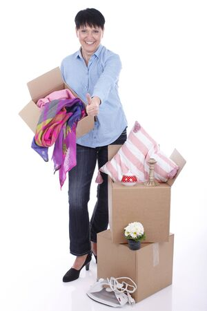 used clothes: Elderly woman with moving boxes isolated Stock Photo