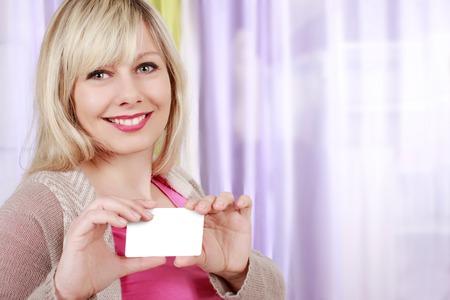 Pretty blond  woman with business card Reklamní fotografie