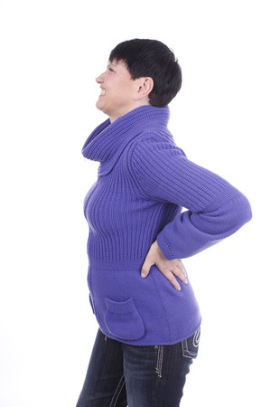 spinal disc: Elderly woman with back pain isolated