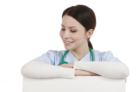 medical assistant: Medical assistant leaning across a white wall isolated