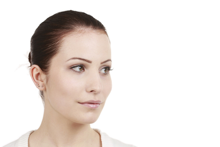 looking sideways: Young woman with beauty face looking sideways isolated