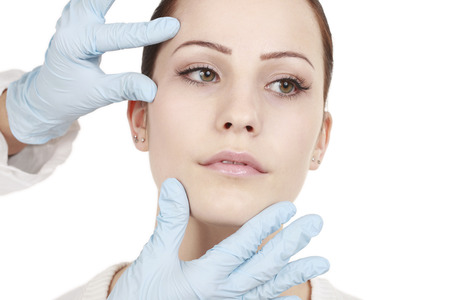 sulcus: Attractive woman gets beauty treatment by a doctor