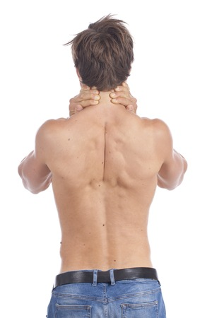 young man: Attractive young man stripped to the waist with back pain