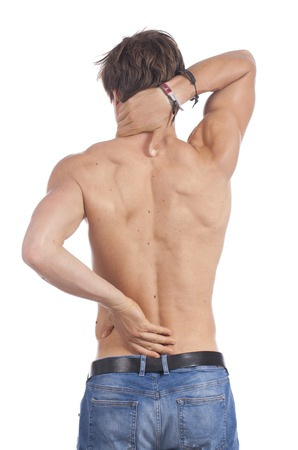 stripped: Attractive young man stripped to the waist with back pain