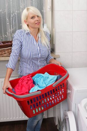homemaker: Housewife carries a laundry basket with dirty washing