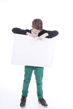 empty board: Teenage boy is pointing on an empty board isolated Stock Photo
