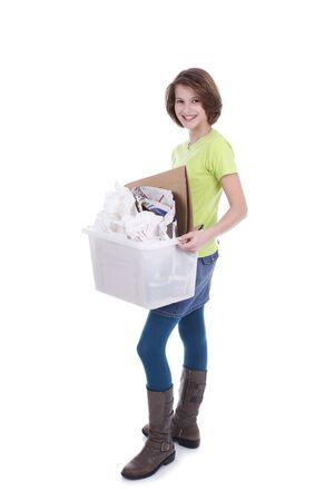 waste paper: Adolescente con una caja de papel usado para su reciclaje