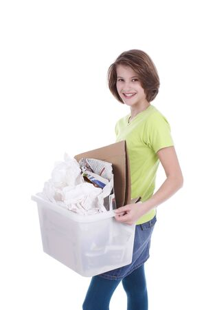 waste paper: Teenage girl with a box of waste paper for recycling