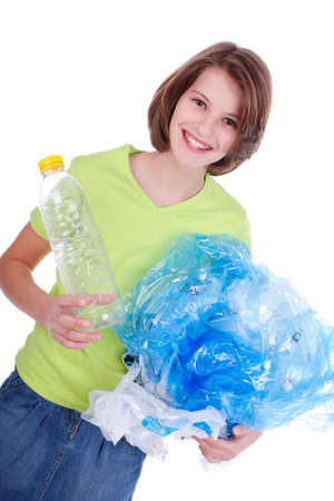 plastic waste: Teenage girl with plastic waste for recycling Stock Photo