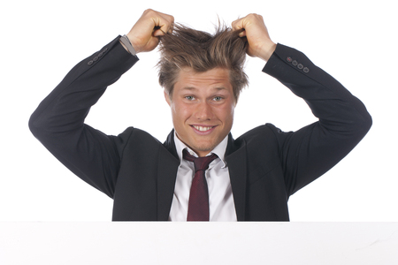 spiky hair: Young crazy businessman with wired hair
