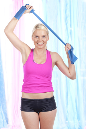 thera: Sporty woman with thera band doing exercises