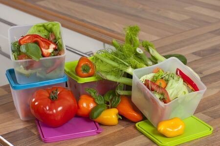 To store the  leftover of the dinner in plastic boxes photo