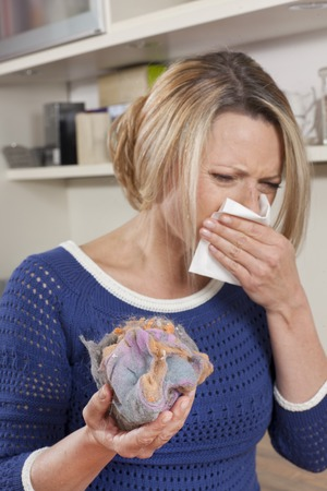 mite: Woman with mite allergy and handkerchief Stock Photo