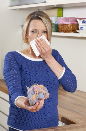 hankie: Woman with mite allergy and handkerchief Stock Photo