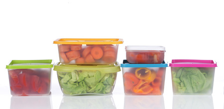 Different platic boxes for storage with vegetables photo