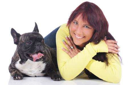 french kiss: young woman with french bulldog isolated