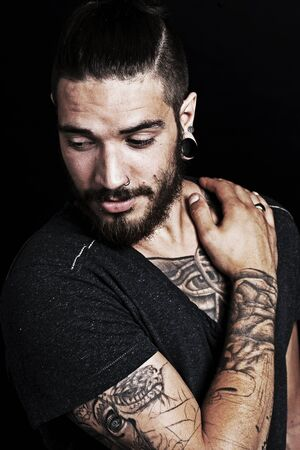 Good looking young man with tattoo