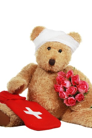 Get well stock photos royalty free get well images sick teddy bear with roses isolated on white altavistaventures Choice Image
