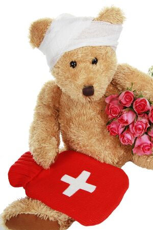 sick teddy bear: Sick teddy Bear with roses isolated on white