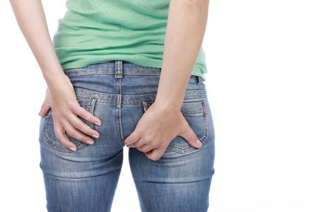diarrea: Mujer con dolor en el culo de las hemorroides Foto de archivo