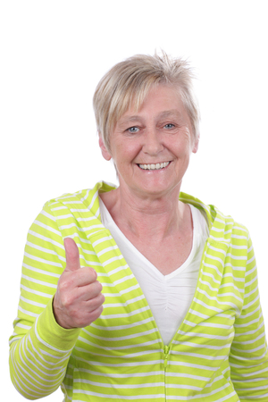 Happy older woman with thumbs up isolated on white