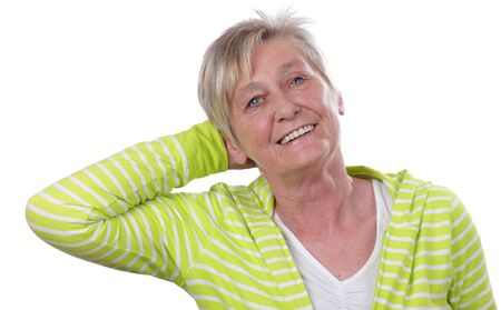woman behind: Old happy woman behind a white wall Stock Photo