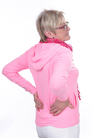Older woman with back pain isolated