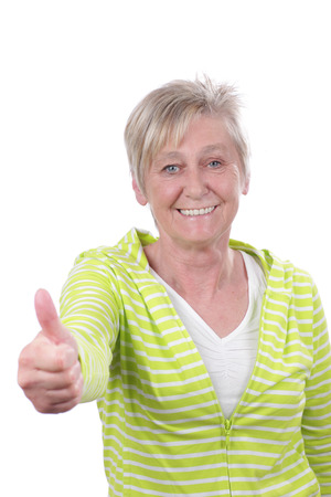 positiv: Happy older woman with thumbs up isolated on white