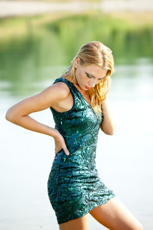 sequin: Attactive woman with green sequin dress outdoor