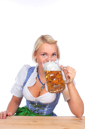 traditional costume: Happy woman in traditional costume is drinking beer isolated