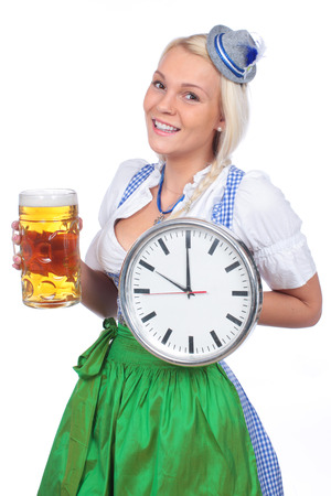 traditional costume: Woman in traditional costume with clock and beer isolated