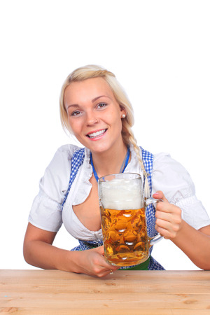prost: Happy woman in traditional costume is drinking beer isolated