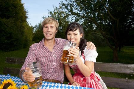 beer garden: Happy bavarian couple in beer garden outdoor