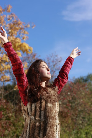 outstretched arms: Attractive woman with outstretched arms in fall outdoor
