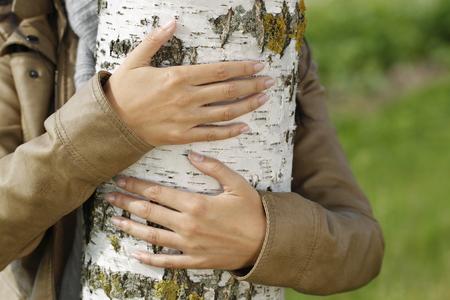 Woman outdoor embraces a birch tree in autumn Reklamní fotografie